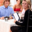 Couple in a restaurant — Stock Photo #8482559