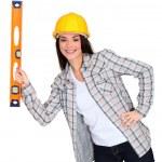 Tradeswoman holding a spirit level — Stock Photo #8483651