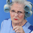 Portrait of angry grandma - Stock Photo