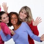 Three female friends waving — Stock Photo #8484210