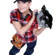 Woman holding circular saw — Stockfoto