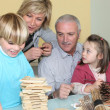 Kids and grandparents playing — Stock Photo