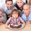 Family celebrating fourth birthday — Stockfoto #8485382