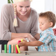 Little boy playing with building blocks — Stock Photo #8485437