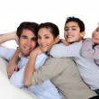 Family piled on top of each other — Stock Photo