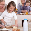 Girls baking with mum and grandma — Stock Photo