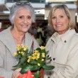 Mom and daughter buying flowers — Stock Photo #8486606