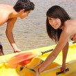 Young couple kayaking — Stok fotoğraf