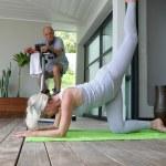 Senior doing gymnastics at home — Stock Photo