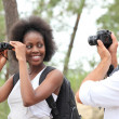 Couple taking photographs in forest — Stock Photo #8487160