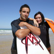 Stock Photo: Couple with surf boards