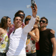 Stock Photo: Group of friends taking self-photo