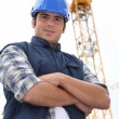 Stock Photo: Foremstood in-front of crane