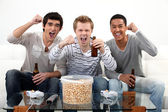 Buddies watching football match on telly — Stock Photo