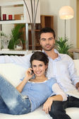 Couple relaxing on sofa — Stock Photo