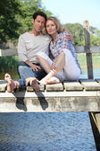 Barefoot couple by the water — Stock Photo
