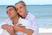 Couple standing on secluded beach — Stock Photo