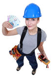 Electrician with a handful of cash — Stock Photo