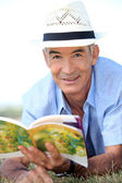Old man reading a book — Stock Photo