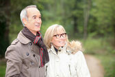 Couple on an autumn stroll — Stock Photo