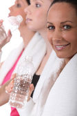 Sportswomen hydrating after effort — Stock Photo