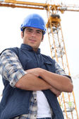 Foreman stood in-front of crane — Stockfoto