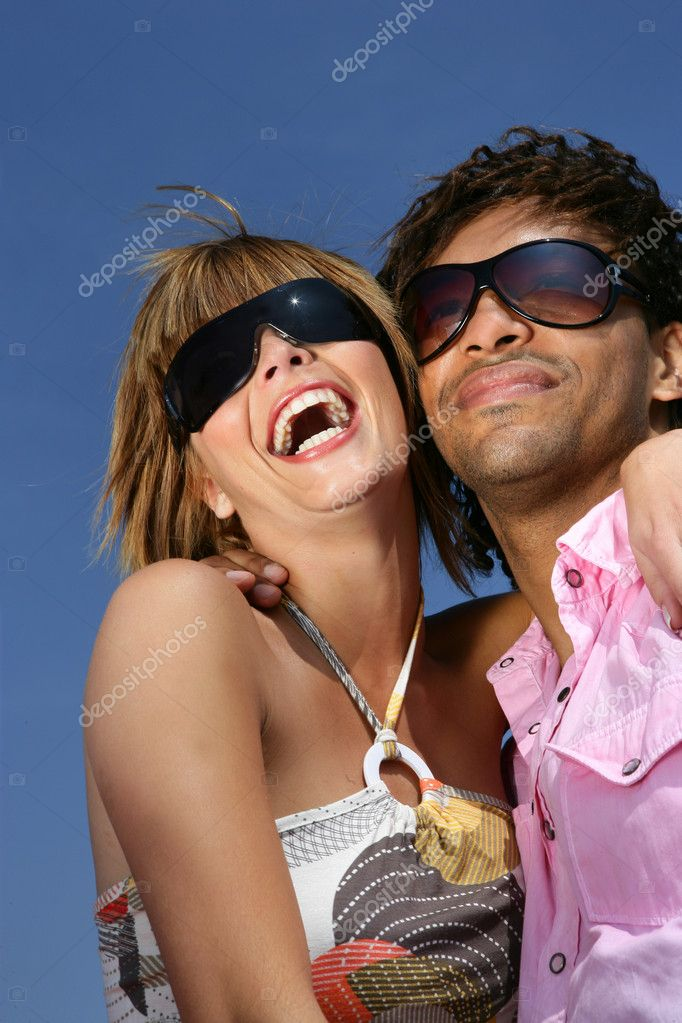 Couple laughing together in the sunshine  Stock Photo #8481660