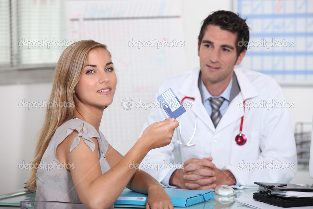 Young person showing European health card — Stock Photo #8486831