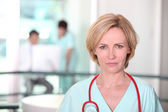 Woman with stethoscope — Stock Photo