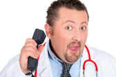 Funny doctor with a telephone — Stock Photo