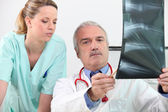 Radiologist and his assistant — Stock Photo