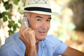 Old man with telephone — Stock Photo