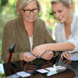 Royalty-Free Stock Photo: Grandmother and granddaughter playing cards