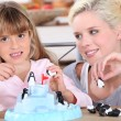 Woman and little girl playing with toys — Stock Photo #8530930