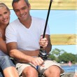 Couple fishing in the sun — Stock Photo #8531156
