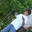 Son playing with diabolo - Stock Photo