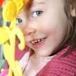 Stock Photo: Portrait of mischievous little girl posing with toy