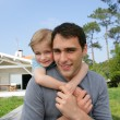 Father and daughter stood in front of their house — Stock Photo #8531574