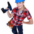 A female construction worker holding a drill. — Stock Photo
