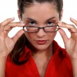 Secretary removing glasses — Stock Photo #8532098