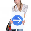 Woman holding traffic sign — Stock Photo