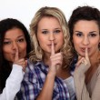 Stock Photo: Three women making shush gesture