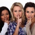 Three women making shush gesture — Stock Photo