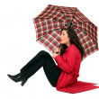 Scottish womsitting with umbrellas — Stock Photo #8533095