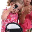 Little girls playing with mummy&#039;s makeup and jewelry - Stok fotoraf