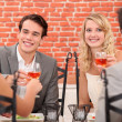 Stock Photo: Friends enjoying meal together