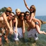 Young having fun at beach — Stock Photo