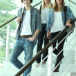Three teenagers walking down stairs — Stock Photo #8535677