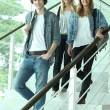 Royalty-Free Stock Photo: Three teenagers walking down stairs