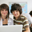 Teenage pupils in class — Stock Photo #8535858